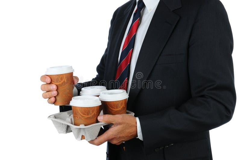 Uomo d'affari con il cassetto del caffè fotografia stock libera da diritti