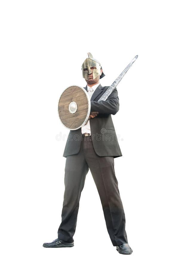 Uomo d'affari con il cavaliere mascherato Sword e lo schermo immagine stock