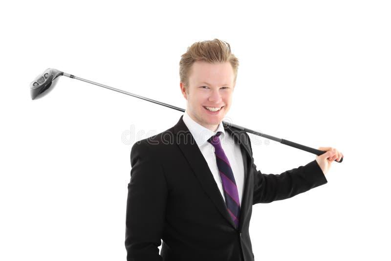 Uomo d'affari con il club di golf fotografia stock libera da diritti
