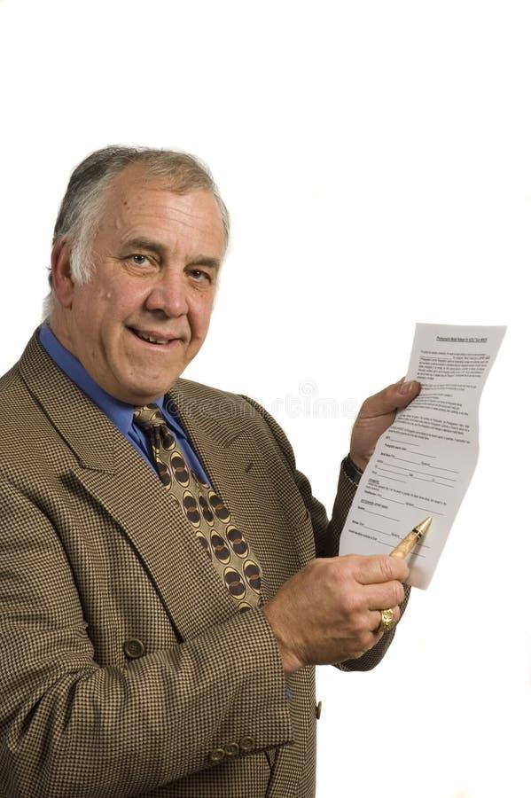 Uomo d'affari con il contratto fotografia stock libera da diritti