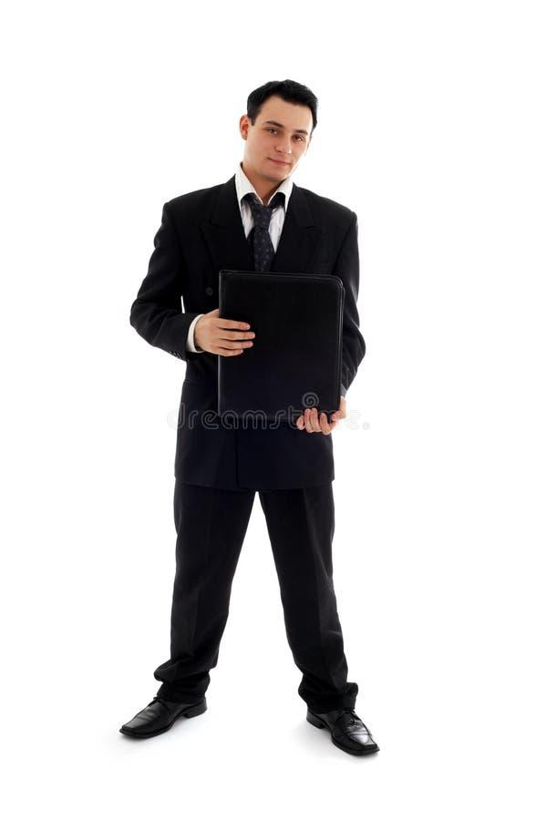 Uomo d'affari con il dispositivo di piegatura nero fotografia stock libera da diritti