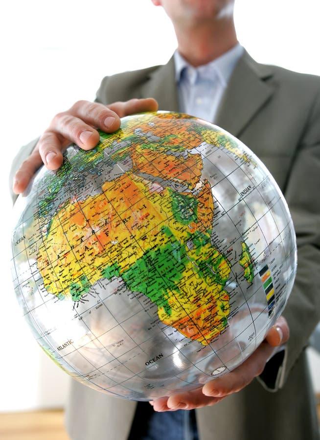 Uomo d'affari con il globo fotografia stock