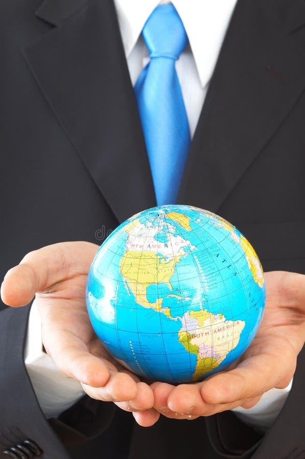 Uomo d'affari con il globo immagine stock