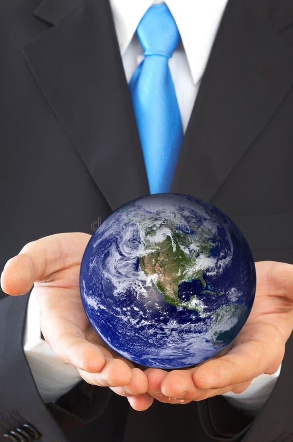 Uomo d'affari con il globo immagini stock