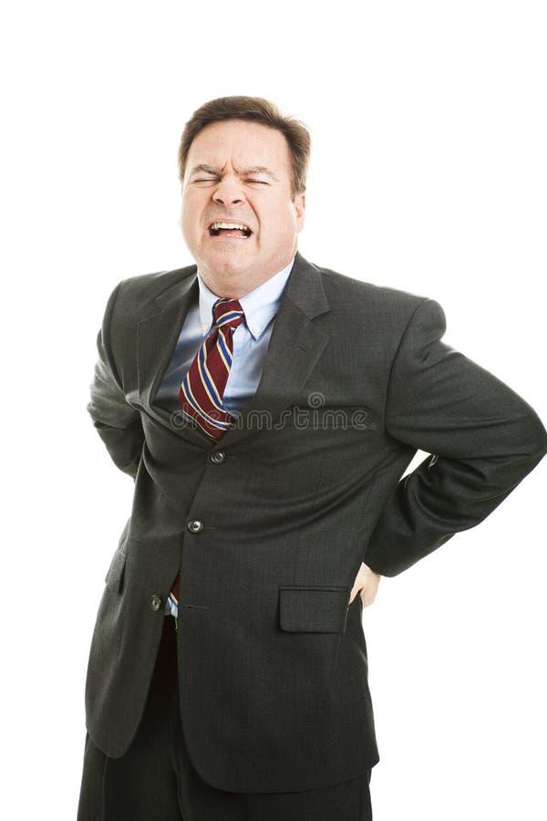 Uomo d'affari con il mal di schiena fotografia stock libera da diritti