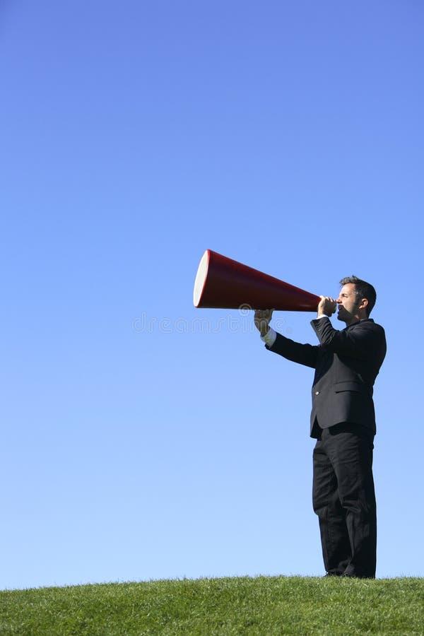 Uomo d'affari con il megafono fotografia stock libera da diritti