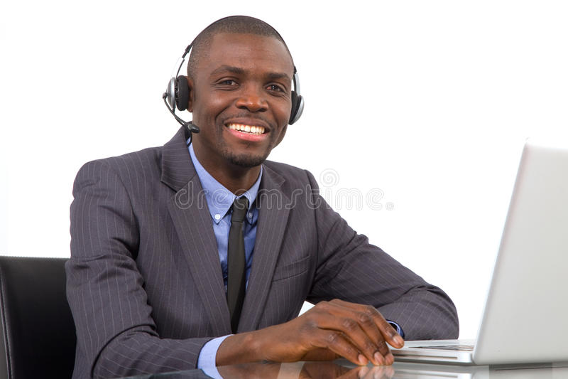Uomo d'affari con il microfono della cuffia avricolare immagini stock