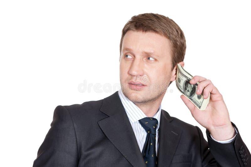 Uomo d'affari con il pacchetto dei dollari immagini stock libere da diritti