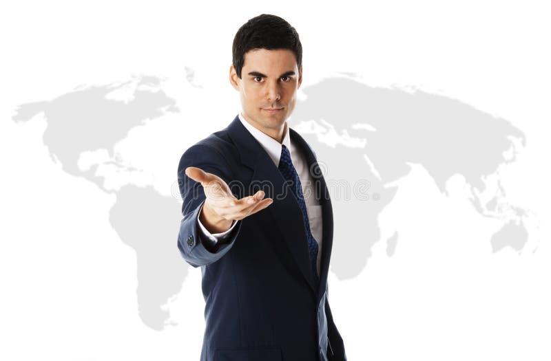 Uomo d'affari con il programma di mondo immagini stock