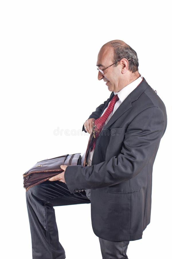 Uomo d'affari con il sacchetto fotografia stock libera da diritti