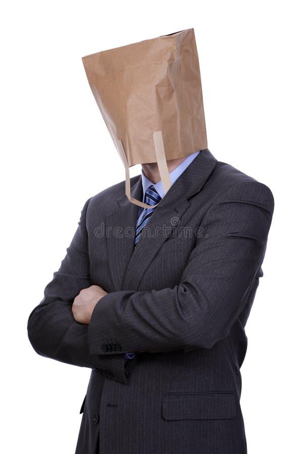 Uomo d'affari con il sacco di carta sulla sua testa immagine stock libera da diritti