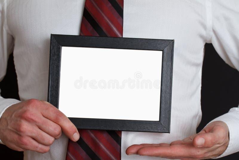 Uomo d'affari con il segno in bianco fotografia stock