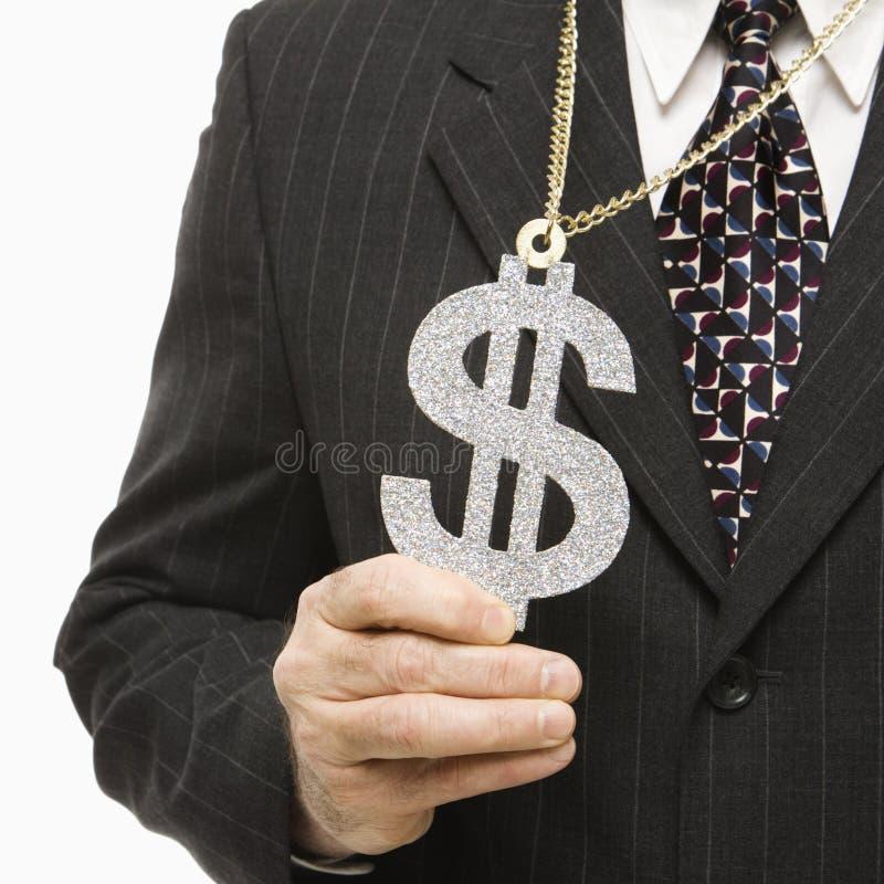 Uomo d'affari con il segno del dollaro fotografia stock