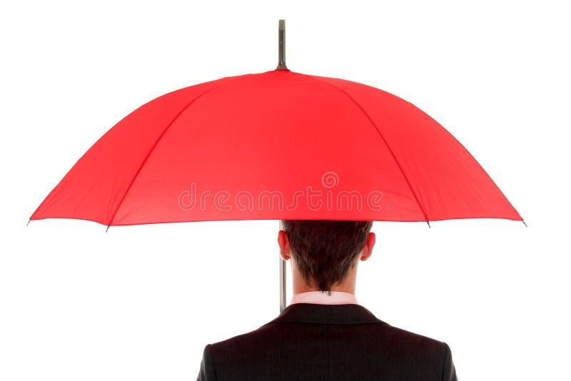 Uomo d'affari con l'ombrello immagine stock libera da diritti