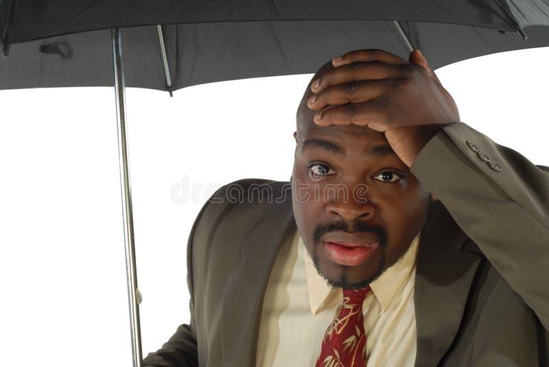 Uomo d'affari con l'ombrello fotografia stock