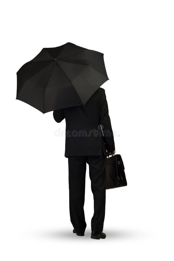 Uomo d'affari con l'ombrello fotografie stock libere da diritti