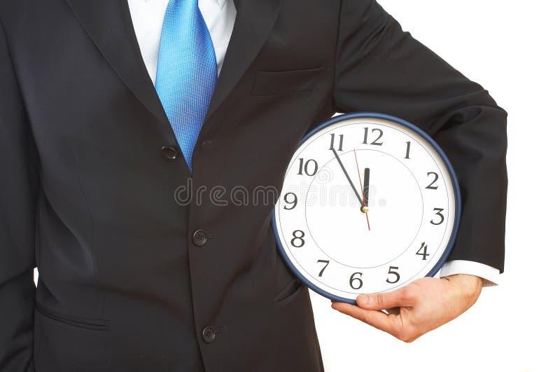 Uomo d'affari con l'orologio immagine stock