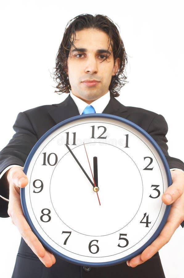 Uomo d'affari con l'orologio fotografie stock