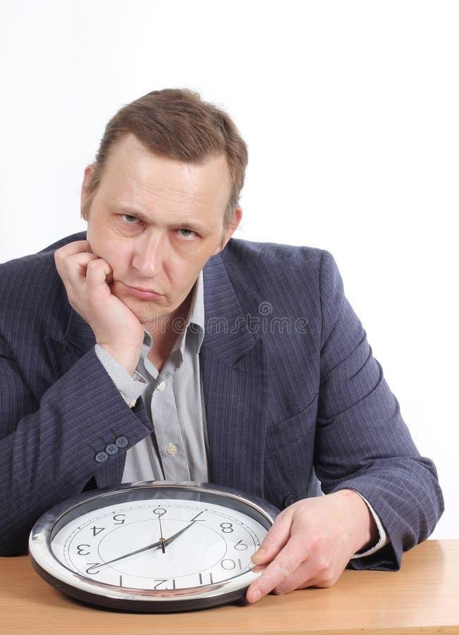 Uomo d'affari con l'orologio fotografia stock