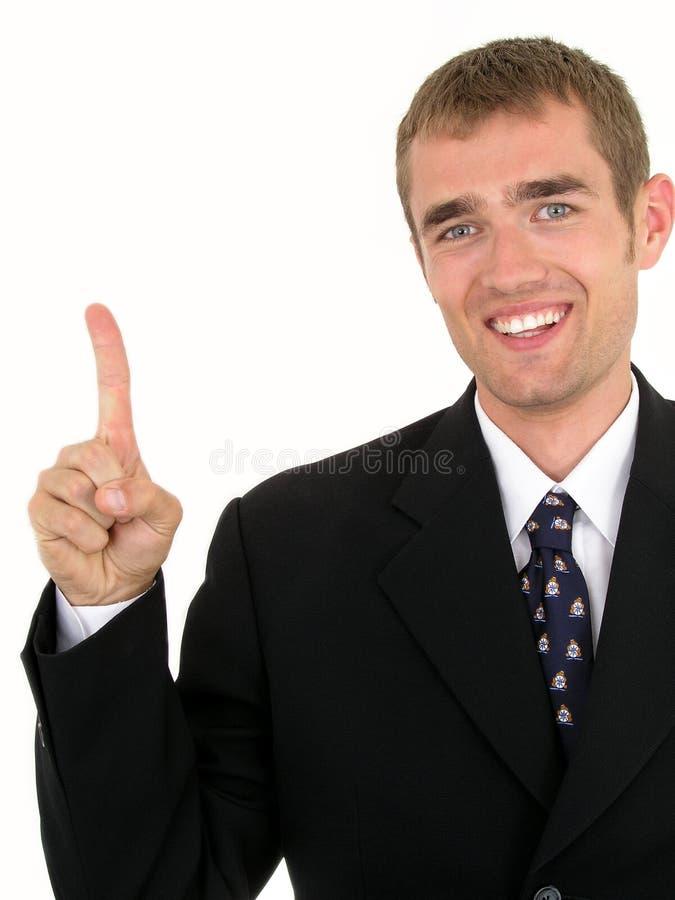 Uomo d'affari con la barretta che indica in su fotografia stock libera da diritti