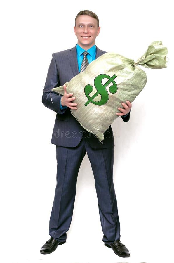 Uomo d'affari con la borsa piena di soldi Vincitore fortunato fotografia stock