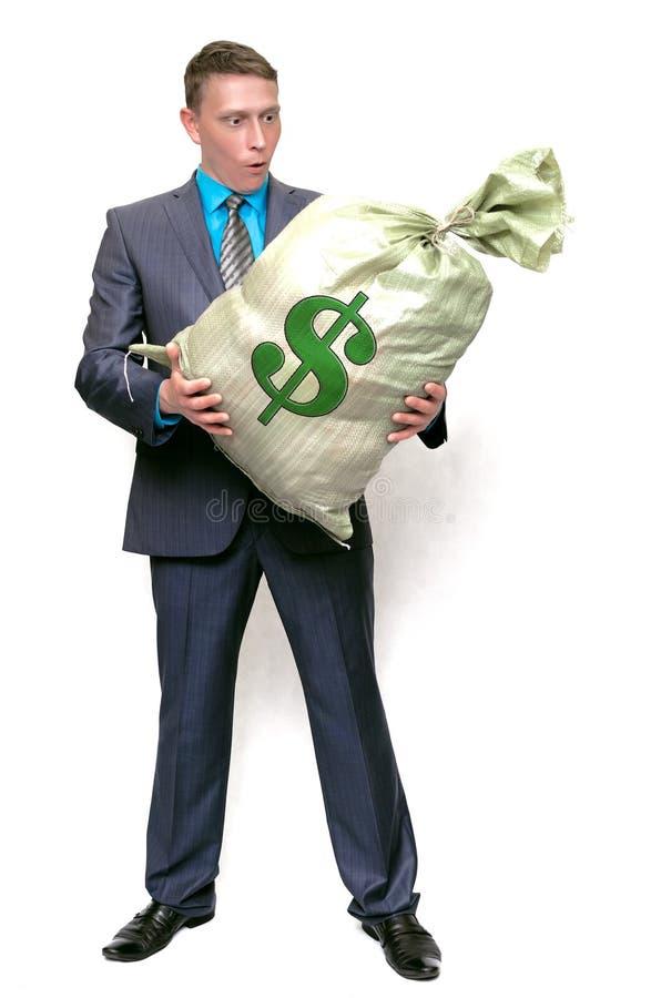 Uomo d'affari con la borsa piena di soldi Vincitore fortunato immagini stock