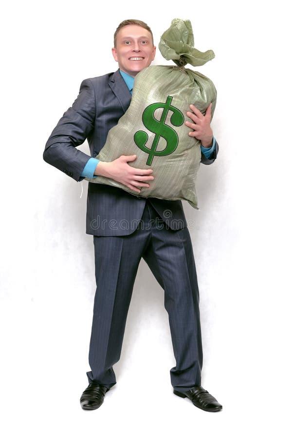 Uomo d'affari con la borsa piena di soldi Vincitore fortunato fotografie stock libere da diritti