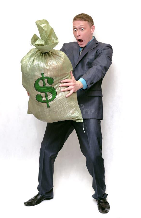 Uomo d'affari con la borsa piena di soldi Vincitore fortunato fotografie stock