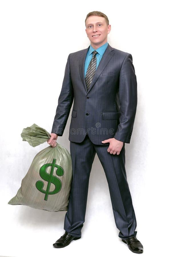 Uomo d'affari con la borsa piena di soldi Vincitore fortunato immagini stock libere da diritti