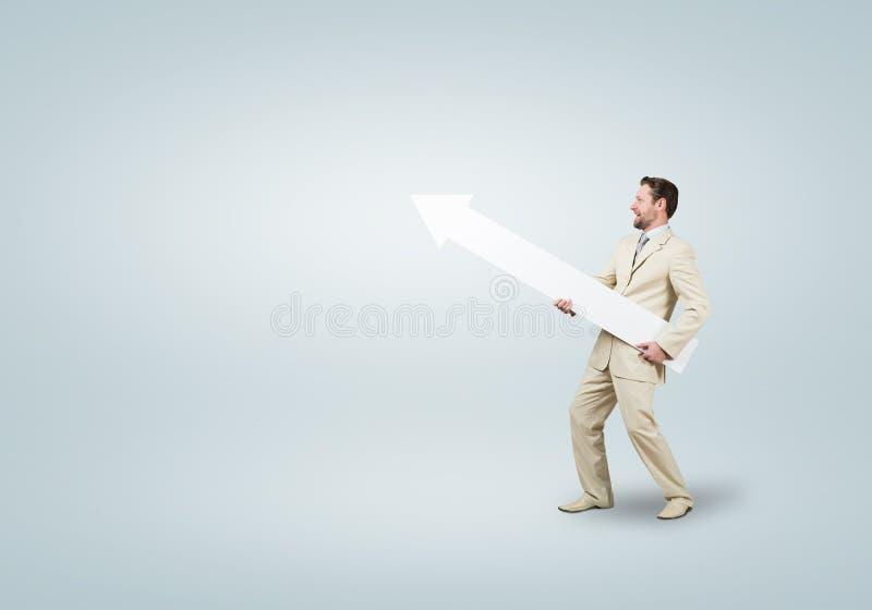 Uomo d'affari con la freccia fotografia stock