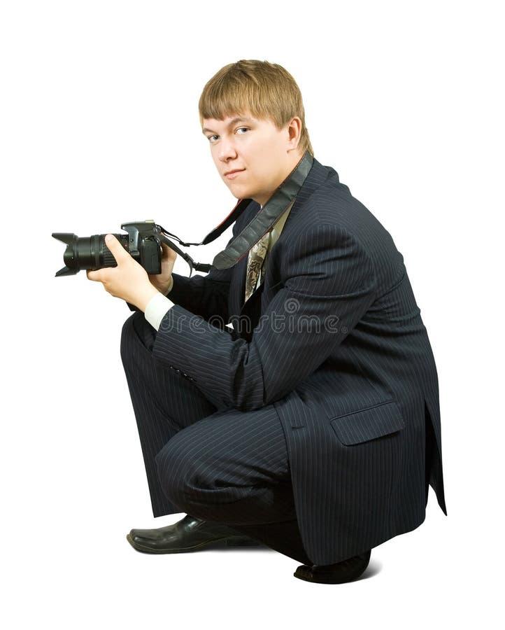 Uomo d'affari con la macchina fotografica immagine stock