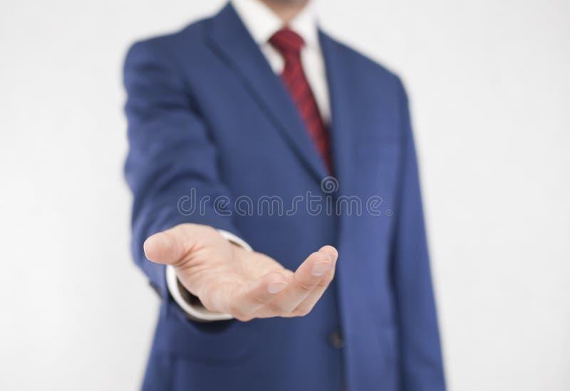Uomo d'affari con la mano aperta fotografie stock libere da diritti