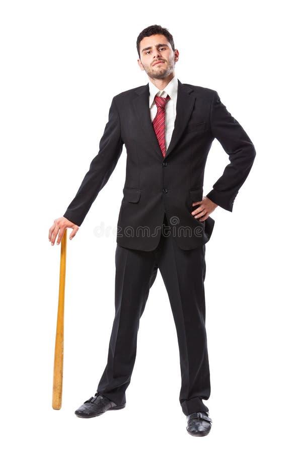 Uomo d'affari con la mazza da baseball immagine stock libera da diritti