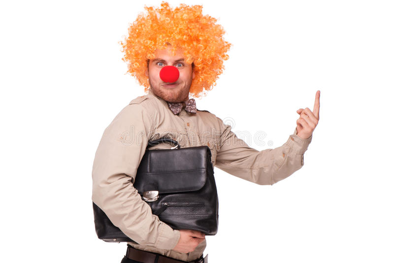 Uomo d'affari con la parrucca ed il naso del pagliaccio immagini stock