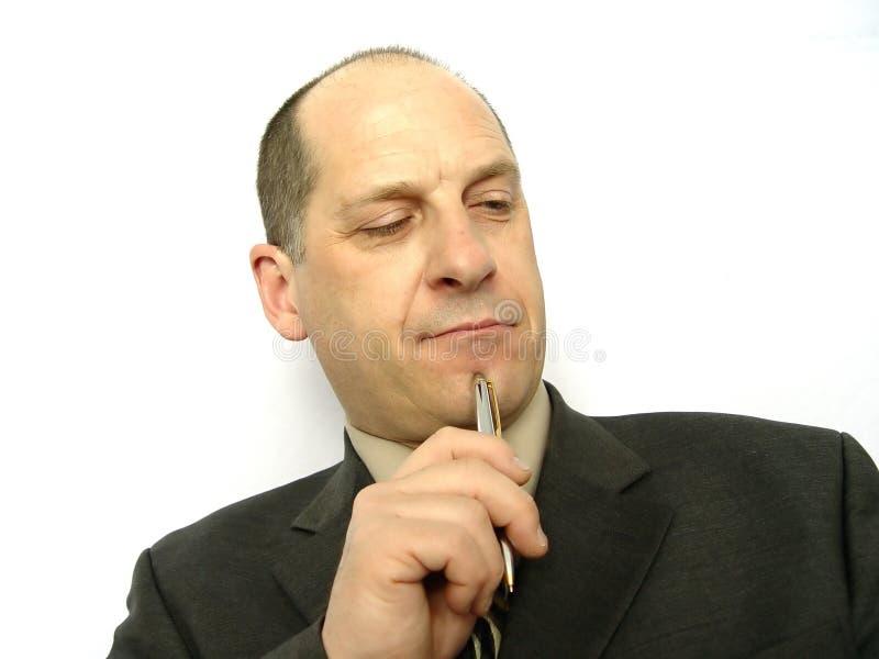 Uomo d'affari con la penna immagine stock