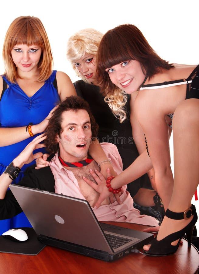 Uomo d'affari con la ragazza in ufficio. immagine stock