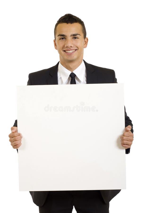 Uomo d'affari con la scheda in bianco fotografia stock libera da diritti