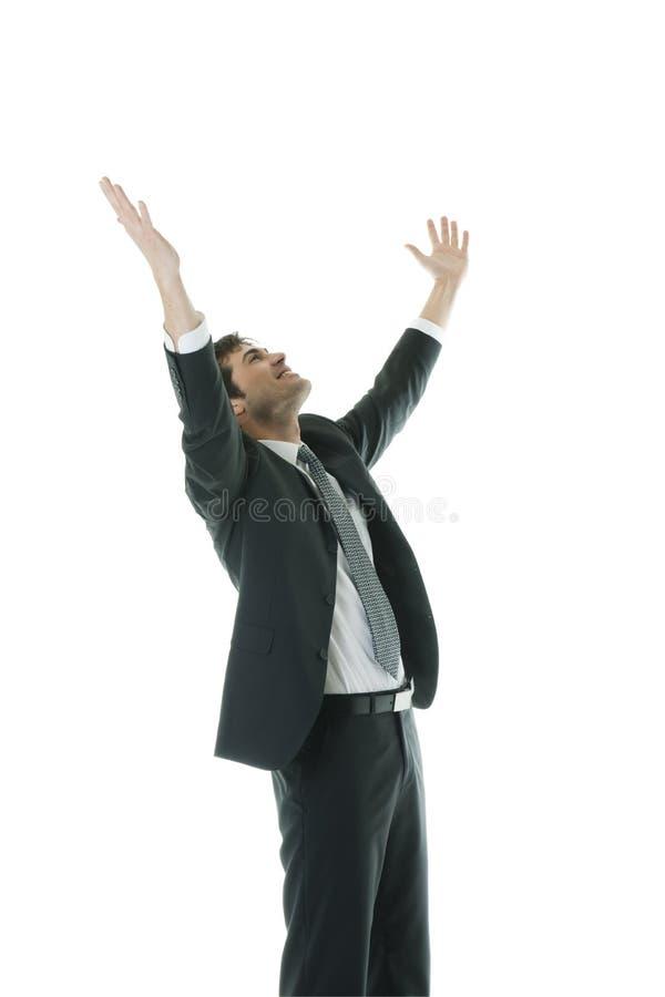 Uomo d'affari con le braccia alzate fotografia stock