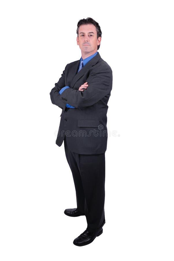 Uomo d'affari con le braccia attraversate immagini stock