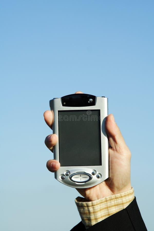 Uomo d'affari con PDA fotografia stock libera da diritti