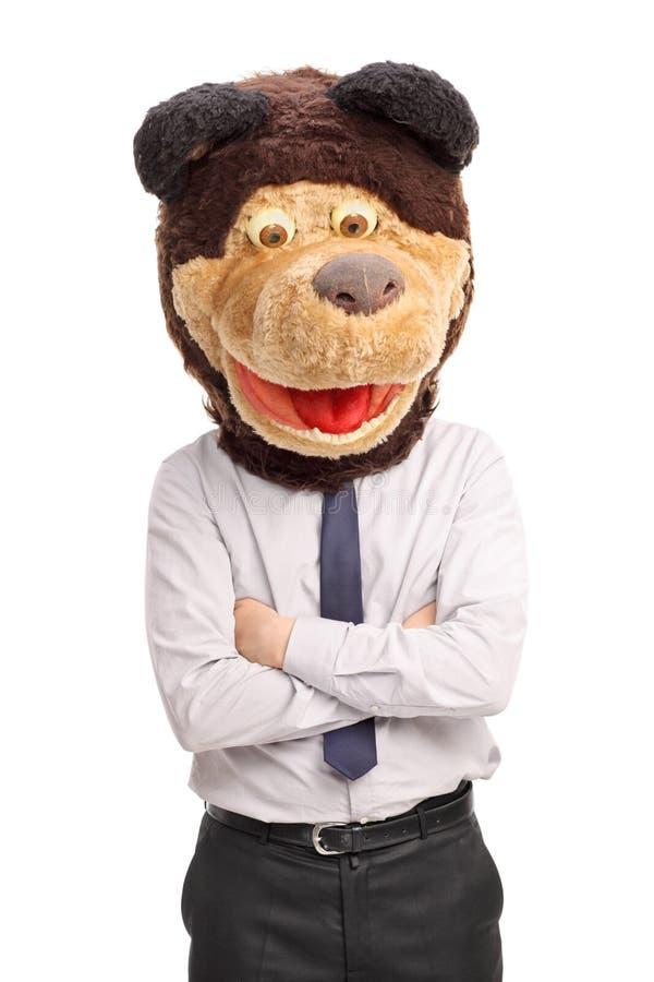 Uomo d'affari con un legame che indossa una maschera dell'orso fotografia stock