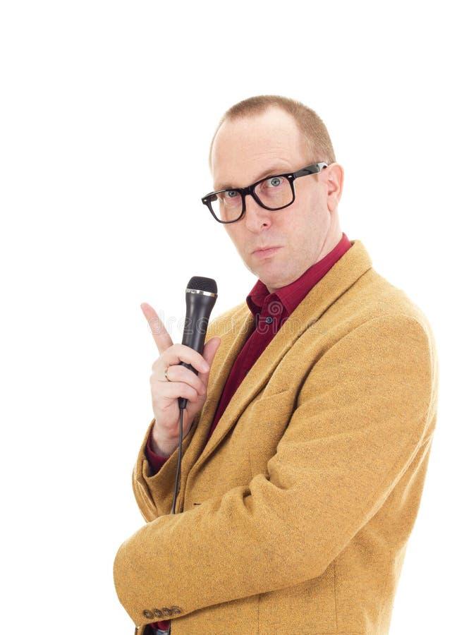 Uomo d'affari con un microfono fotografia stock libera da diritti