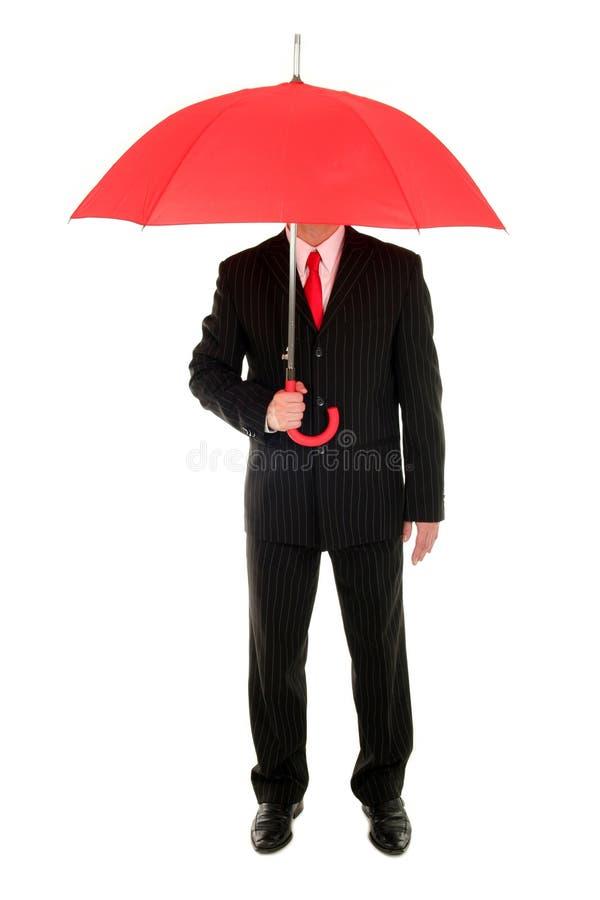 Uomo d'affari con un ombrello fotografia stock