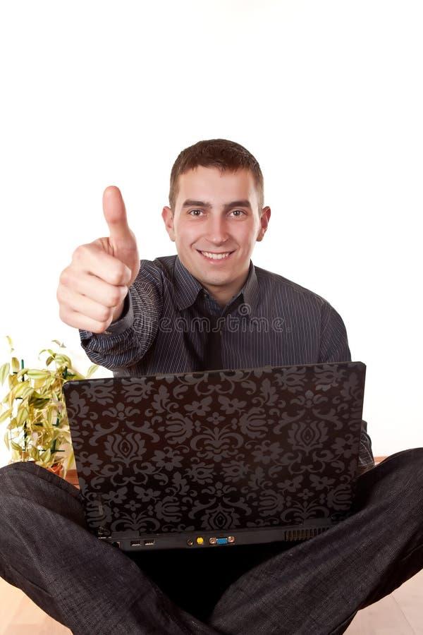 Uomo d'affari con un pollice in su fotografie stock libere da diritti