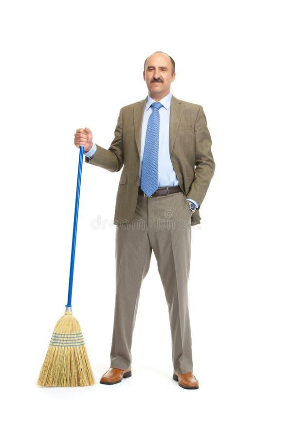 Uomo d'affari con una scopa fotografia stock
