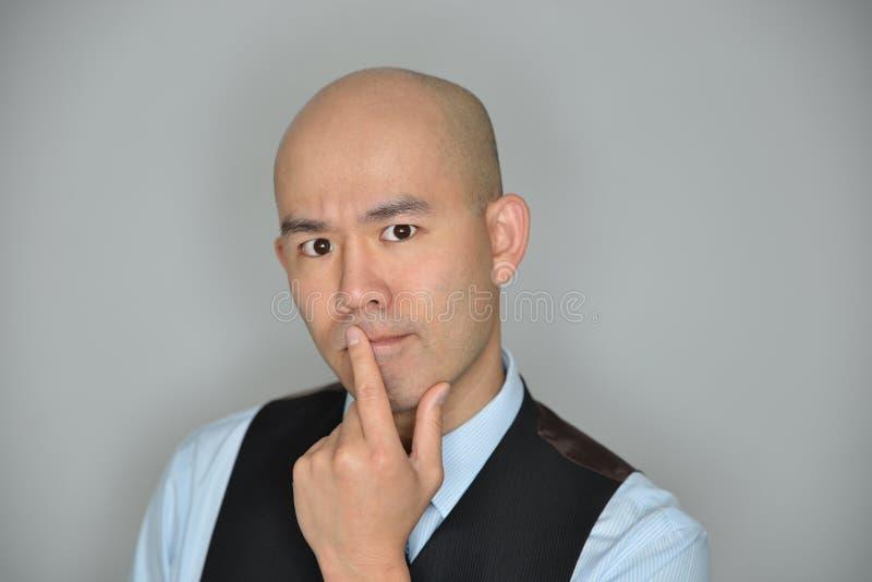 Uomo d'affari Confused ed espressione perplessa immagini stock libere da diritti