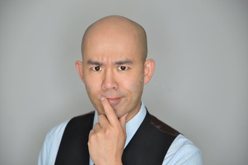 Uomo d'affari Confused ed espressione perplessa immagine stock