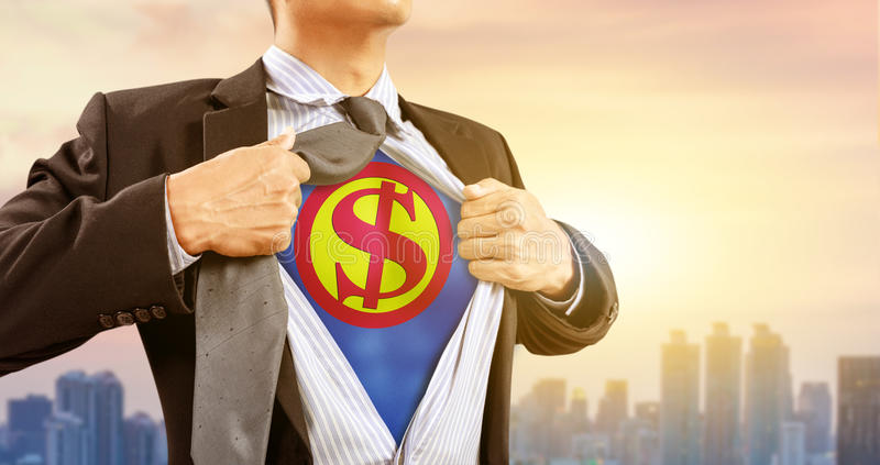 Uomo d'affari in costume del supereroe con il simbolo di dollaro immagini stock