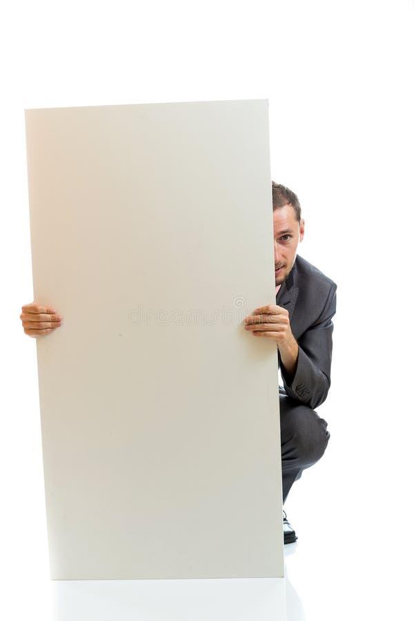 Uomo d'affari del legame del vestito che visualizza cartello immagine stock libera da diritti