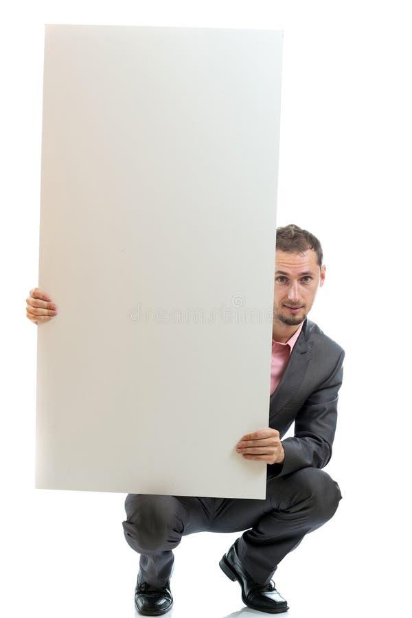 Uomo d'affari del legame del vestito che visualizza cartello fotografia stock
